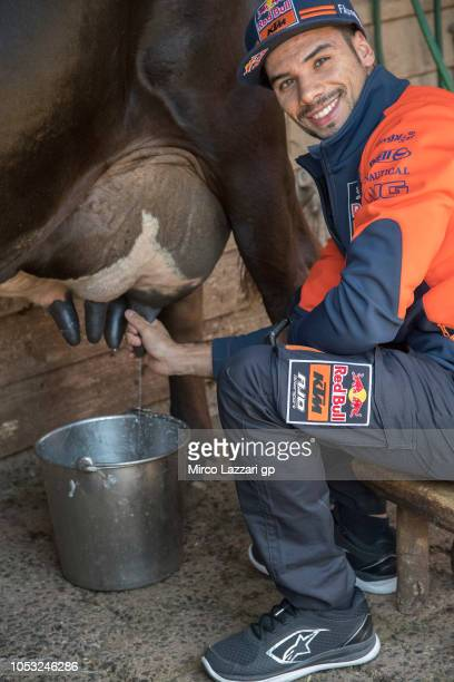 Miguel Oliveira of Portugal and Red Bull KTM Ajo smiles during the preevent 'MotoGP Riders visiting the Churchill Farm' during the MotoGP of...