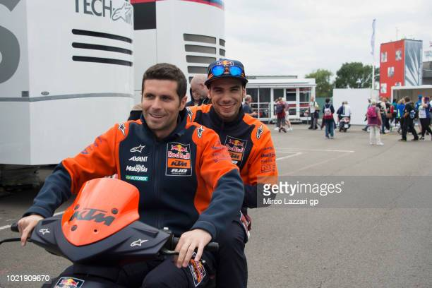 Miguel Oliveira of Portugal and Red Bull KTM Ajo smiles in scooter in paddock during the MotoGp Of Great Britain Previews at Silverstone Circuit on...