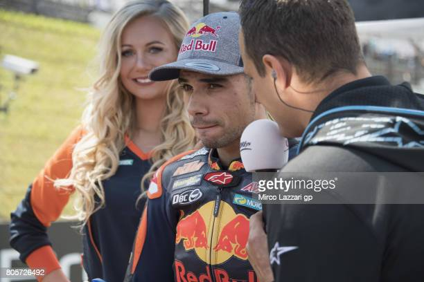 Miguel Oliveira of Portugal and Red Bull KTM Ajo speaks with journalist on the grid during the Moto2 race during the MotoGp of Germany Race at...