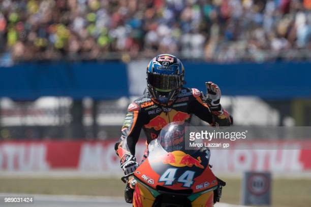 Miguel Oliveira of Portugal and Red Bull KTM greets the fans at the end of the Moto2 race during the MotoGP Netherlands Race on July 1 2018 in Assen...