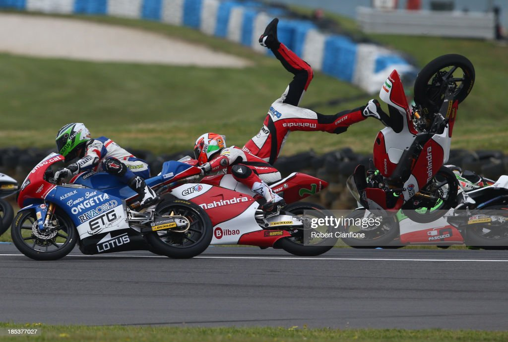 Miguel Oliveira of Portugal and rider of the #44 Mahindra Racing Mahindra crashes out during the Moto3 race at the Australian MotoG at Phillip Island Grand Prix Circuit on October 20, 2013 in Phillip Island, Australia.