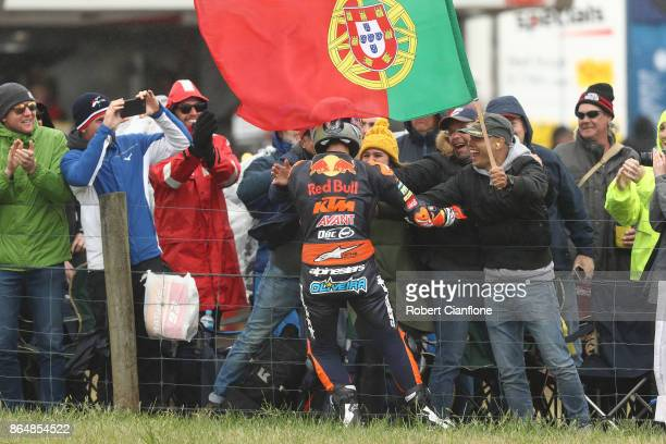 Miguel Oliveira of Portugal and rider of the Red Bull KTM AJO KTM celebrates after winning the Moto2 race during the 2017 MotoGP of Australia at...