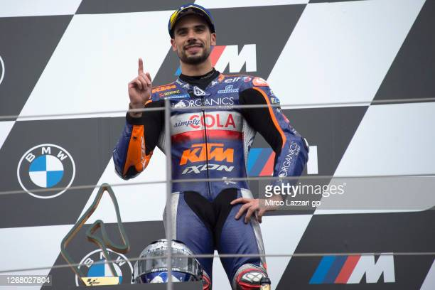 Miguel Oliveira of Portugal and Team KTM Tech 3 celebrates on the podium his first MotoGP victory at the end of the MotoGP race during the MotoGP Of...