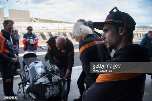 Miguel Oliveira of Portugal and Team KTM Tech 3 looks on near the bike in box during the MotoGP Tests In Valencia at Ricardo Tormo Circuit on...