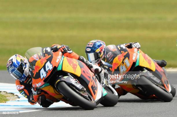 Miguel Oliveira of Portugal and the Red Bull KTM AJO leads Brad Binder of South Africa and the Red Bull KTM AJO during the Moto2 race during the 2017...