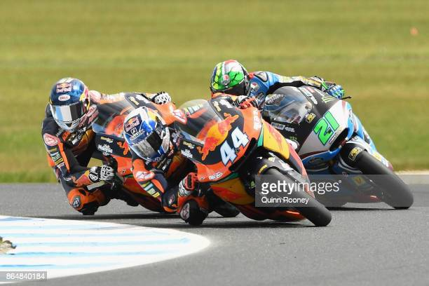 Miguel Oliveira of Portugal and the Red Bull KTM AJO leads Franco Morbidelli of Italy and the EG 00 Marc VDS and Brad Binder of South Africa and the...