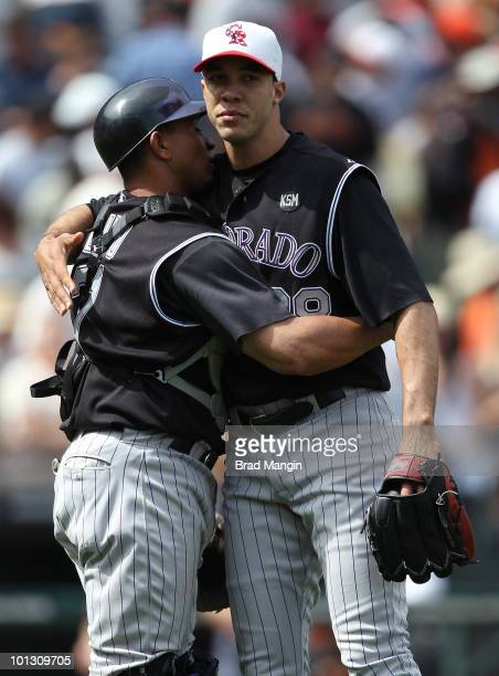 Miguel Olivo and Ubaldo Jimenez of the Colorado Rockies hug after the game against the San Francisco Giants at ATT Park on May 31 2010 in San...