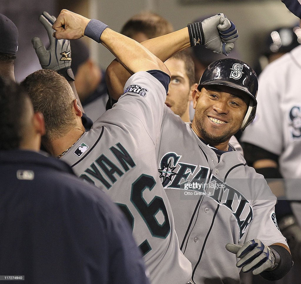 Miguel Olivo #30 (R) of the Seattle Mariners is congratulated by Brendan Ryan #26 after hitting a two-run homer against the Florida Marlins at Safeco Field on June 24, 2011 in Seattle, Washington. The Mariners defeated the Marlins 5-1.