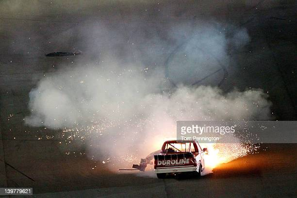 Miguel Paludo driver of the Duroline Brakes and Components Chevrolet spins and catches fire after hitting the wall during the NASCAR Camping World...