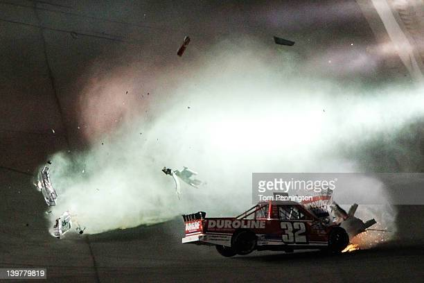 Miguel Paludo driver of the Duroline Brakes and Components Chevrolet spins through the air after hitting the wall during the NASCAR Camping World...