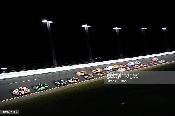 Miguel Paludo driver of the Duroline Brakes and Components Chevrolet leads the field during the NASCAR Camping World Truck Series NextEra Energy...