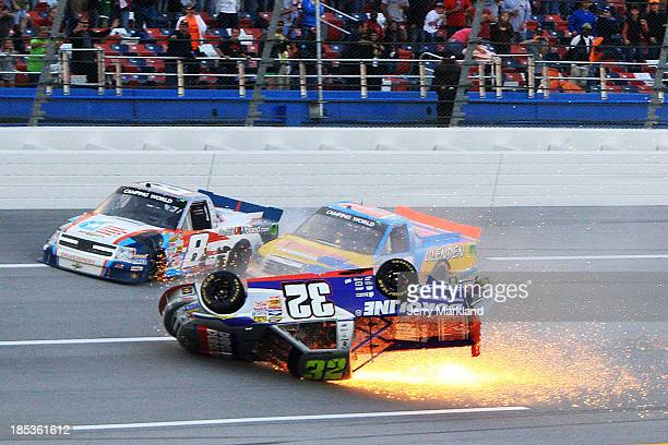 Miguel Paludo driver of the Duroline Chevrolet slides down the track on his roof after crashing on the last lap of the Camping World Truck Series...