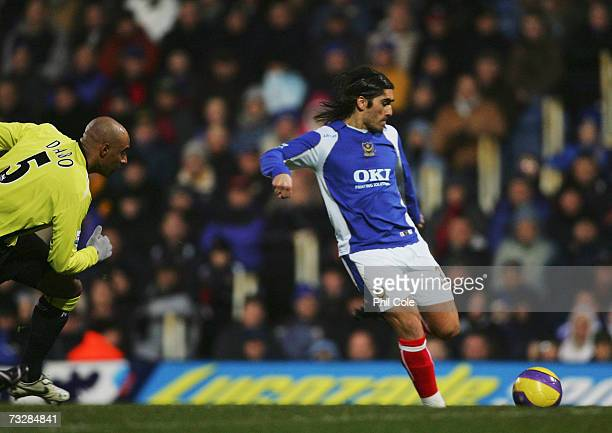 Miguel Pedro Mendes of Portsmouth scores against Manchester City during the Barclays Premiership match between Portsmouth and Manchester City at...