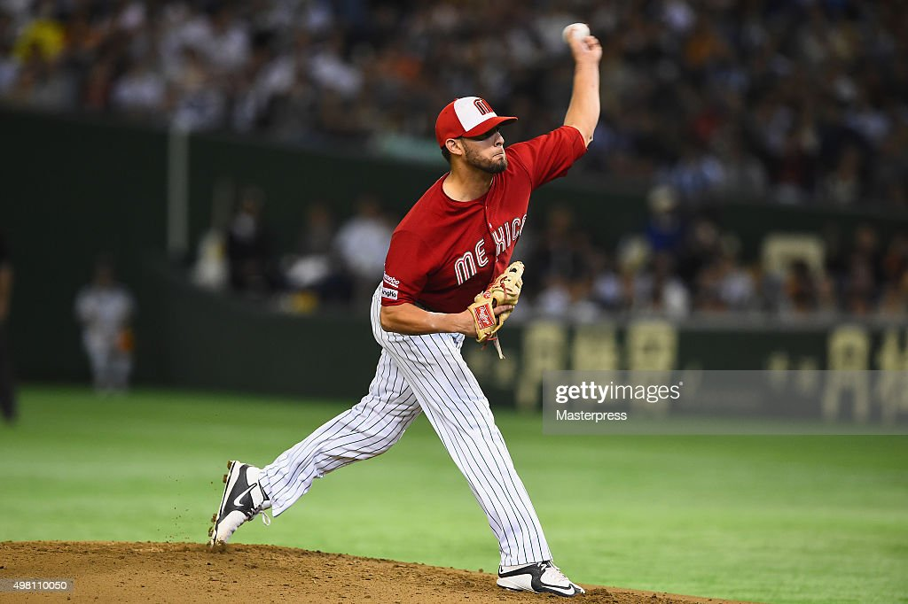 Miguel Pena #5 of Mexico pitches in the bottom half of the first inning during the WBSC Premier 12 third place play off match between Japan and Mexico at the Tokyo Dome on November 21, 2015 in Tokyo, Japan.