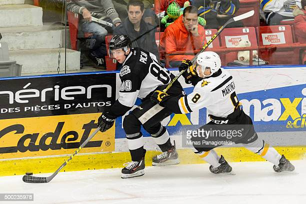 Miguel Picard of the BlainvilleBoisbriand Armada skates with the puck against Phelix Martineau of the Cape Breton Screaming Eagles during the QMJHL...
