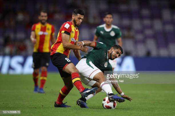 Miguel Ponce of CD Guadalajara is challenged by Anice Badri of ES Tunis during the FIFA Club World Cup UAE 2018 5th Place Match between ES Tunis and...
