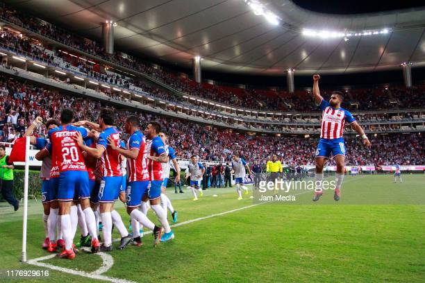 Miguel Ponce of Chivas celebrates after teammate Alan Pulido scored the second goal of his team during the 11th round match between Chivas and...
