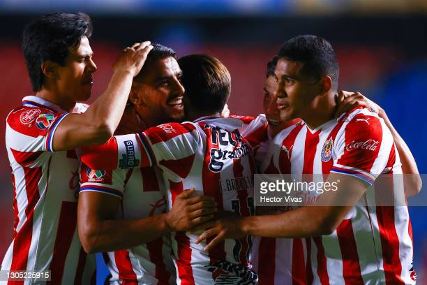 Miguel Ponce of Chivas celebrates with teammates after scoring the second goal of his team during the 9th round match between Queretaro and Chivas as...