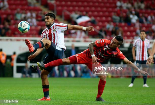 Miguel Ponce of Chivas fights for the ball with Diego Chavez of Veracruz during the fifth round match between Chivas and Veracruz as part of the...