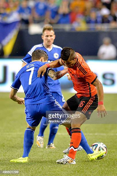 Miguel Ponce of Mexico vies for the ball with Muhamed Besic of Bosnia during a friendly match at the Soldier Field in Chicago United States on June 3...