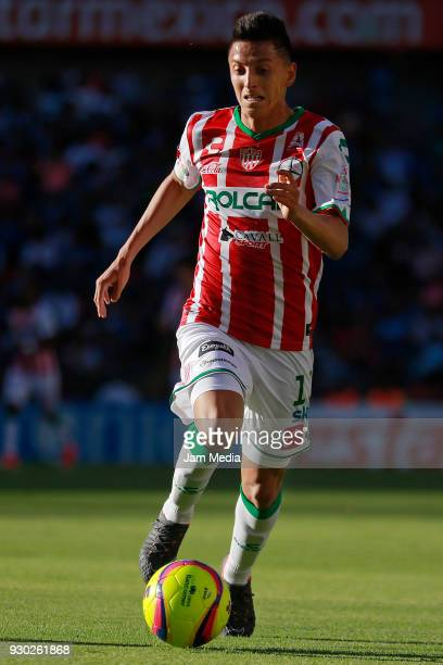 Miguel Ponce of Necaxa drives the ball during the 11th round match between Queretaro and Necaxa as part of the Torneo Clausura 2018 Liga MX at La...