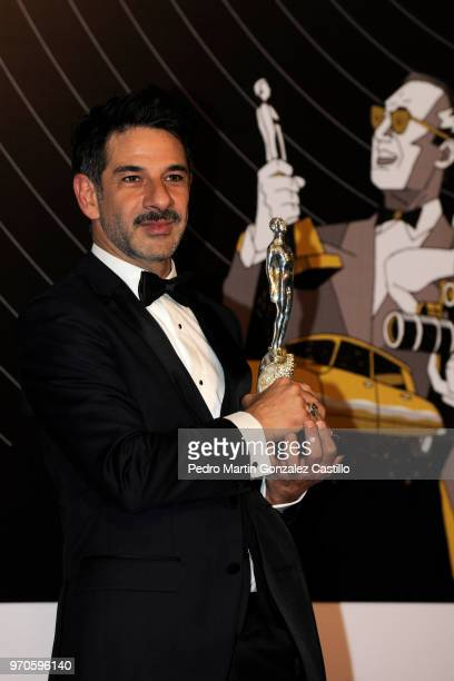 Miguel Rodarte poses with the Ariel Award after winning Actor in Supporting Role for 'Tiempo compartido' during 60th Ariel Awards at Palacio de...