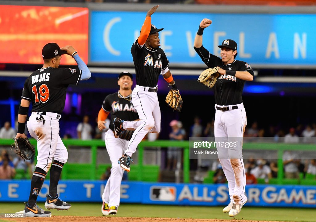 Miguel Rojas #19, Giancarlo Stanton #27, Dee Gordon #9, and Christian Yelich #21 of the Miami Marlins celebrate the win after the game between the Miami Marlins and the Colorado Rockies at Marlins Park on August 12, 2017 in Miami, Florida.