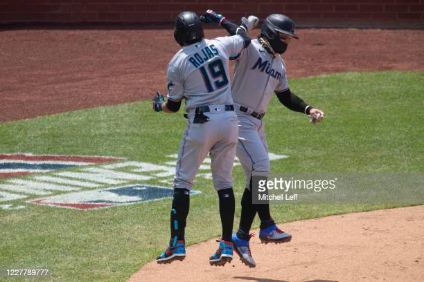 Miguel Rojas of the Miami Marlins celebrates with Isan Diaz after hitting a three run home run in the top of the second inning against the...