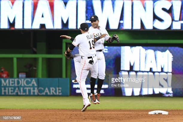 Miguel Rojas of the Miami Marlins celebrates with Starlin Castro after defeating the Philadelphia Phillies at Marlins Park on September 5 2018 in...