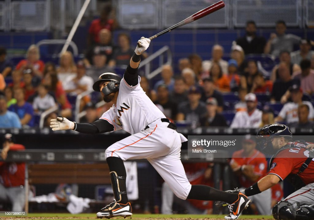 Miguel Rojas #19 of the Miami Marlins doubles for a rbi in the fifth inning against the Washington Nationals at Marlins Park on July 29, 2018 in Miami, Florida.
