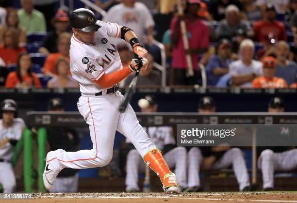 Miguel Rojas of the Miami Marlins hits during a game against the Philadelphia Phillies at Marlins Park on August 31 2017 in Miami Florida
