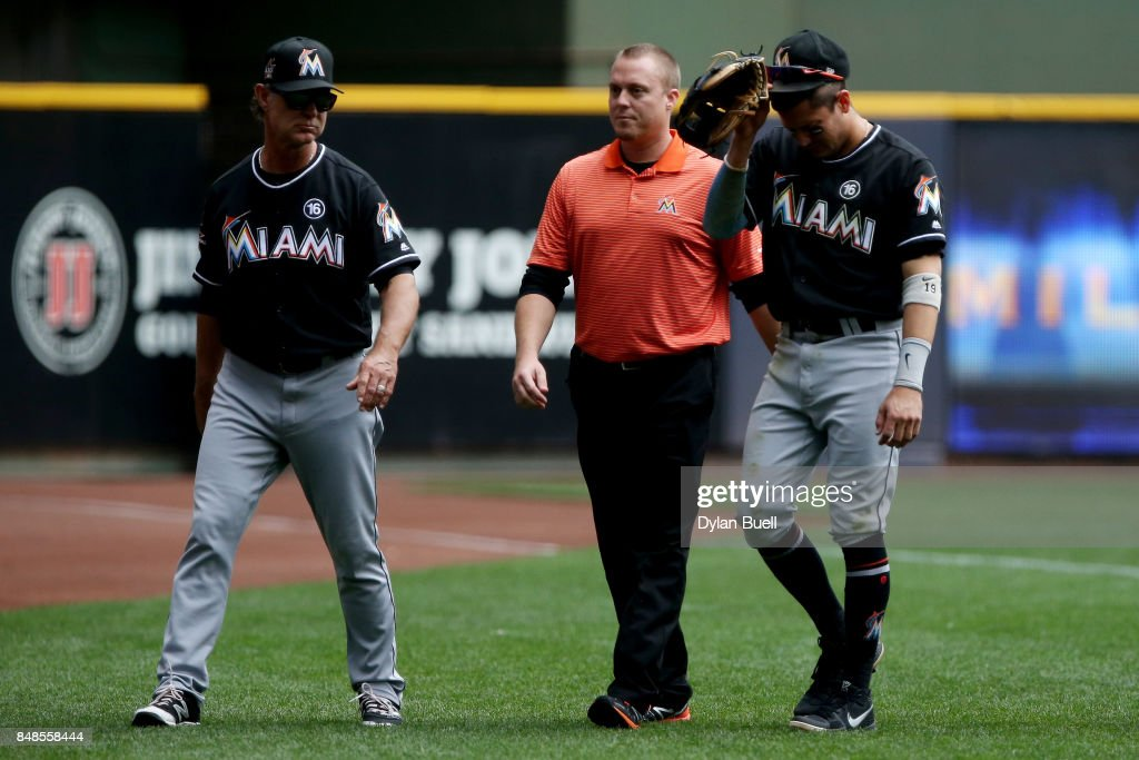 Miguel Rojas #19 of the Miami Marlins leaves the game after being injured in the second inning against the Milwaukee Brewers at Miller Park on September 17, 2017 in Milwaukee, Wisconsin.