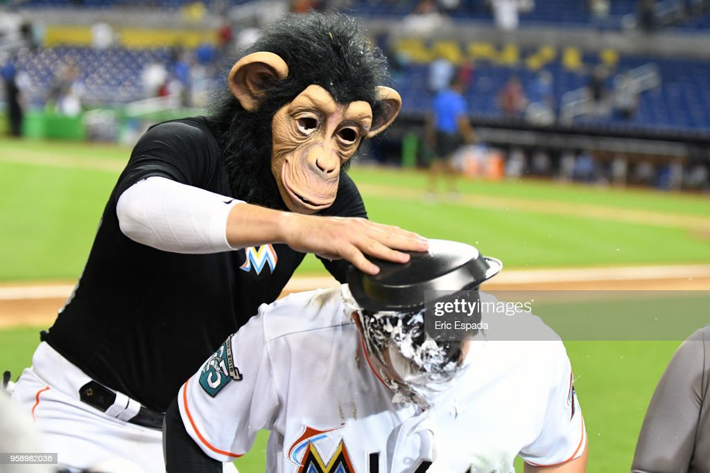 Miguel Rojas #19 of the Miami Marlins puts shaving cream in the face of Martin Prado #14 after defeating the Los Angeles Dodgers at Marlins Park on May 15, 2018 in Miami, Florida.