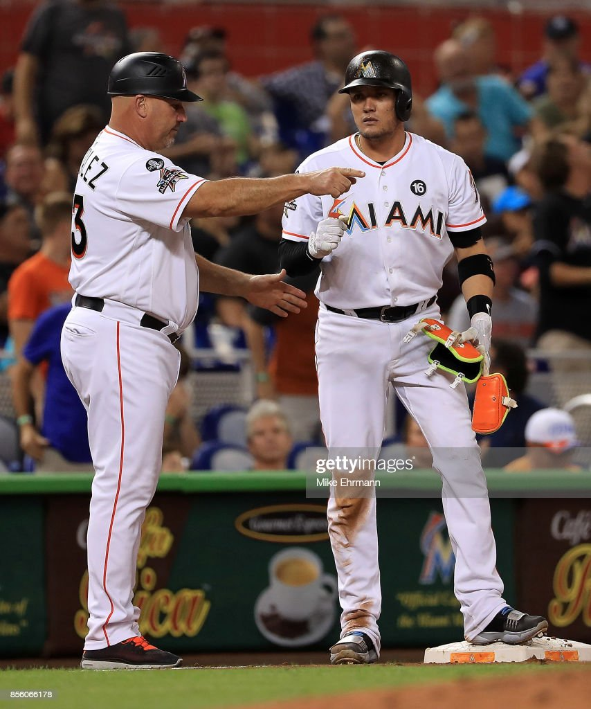 Miguel Rojas #19 of the Miami Marlins reacts after a triple during a game against the Atlanta Braves at Marlins Park on September 30, 2017 in Miami, Florida.