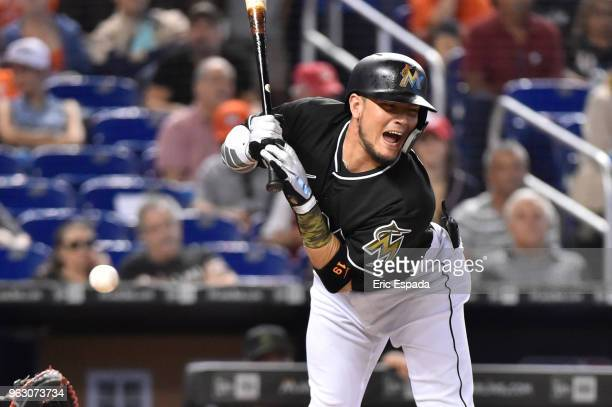 Miguel Rojas of the Miami Marlins reacts after getting hit by a pitch during the second inning against the Washington Nationals at Marlins Park on...