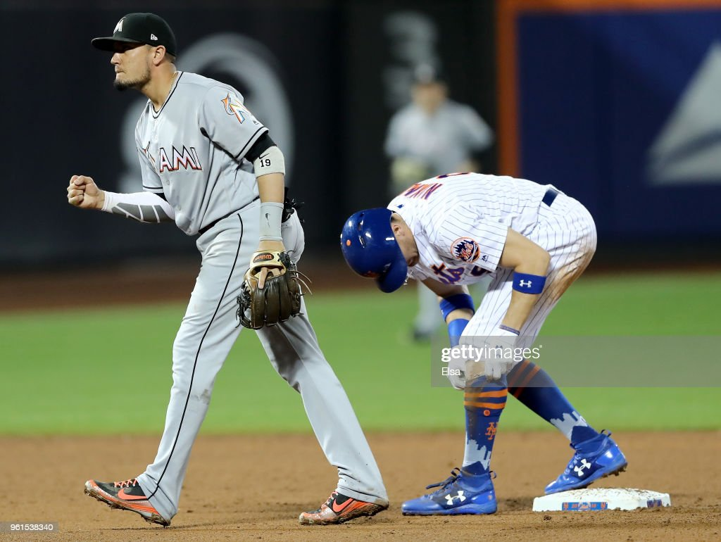 Miguel Rojas #19 of the Miami Marlins reacts after he turned the double play to end the eighth inning as Brandon Nimmo #9 of the New York Mets is out at second at Citi Field on May 22, 2018 in the Flushing neighborhood of the Queens borough of New York City.