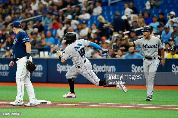 Miguel Rojas of the Miami Marlins rounds first after hitting a double off of Diego Castillo of the Tampa Bay Rays in the first inning of a game at...