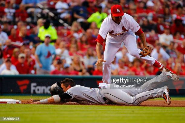 Miguel Rojas of the Miami Marlins slides into third base against Jack Flaherty of the St Louis Cardinals in the second inning at Busch Stadium on...