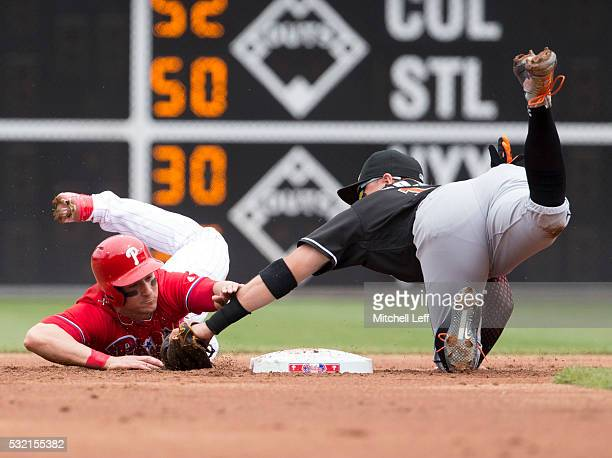 Miguel Rojas of the Miami Marlins tags out David Lough of the Philadelphia Phillies trying to steal second base in the bottom of the first inning at...