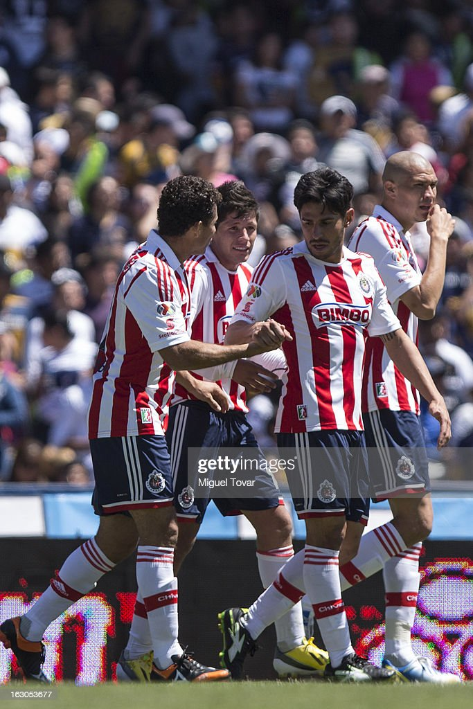 Miguel Sabah of Chivas celebrates with teammates after scoring during a match between Pumas and Chivas as part of the Clausura 2013 at Olympic stadium on March 03, 2013 in Mexico City, Mexico.