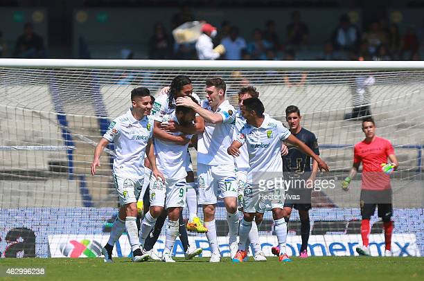 Miguel Sabah of Leon celebrates with teammates after scoring the second goal of his team during a match between Pumas UNAM and Leon as part of 5th...