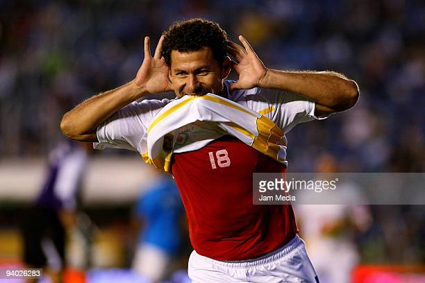Miguel Sabah of Morelia celebrates scored goal during their semifinals match as part of the 2009 Opening tournament in the Mexican Football League at...