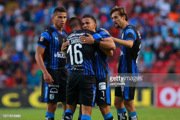 Miguel Samudio celebrates with teammate Camilo Da Silva Sanvezzo of Queretaro during the 17th round match between Queretaro and Necaxa as part of the...