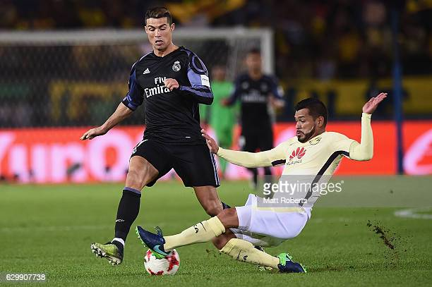 Miguel Samudio of Club America competes for the ball against Cristiano Ronaldo of Real Madrid during the FIFA Club World Cup Japan semi-final match...