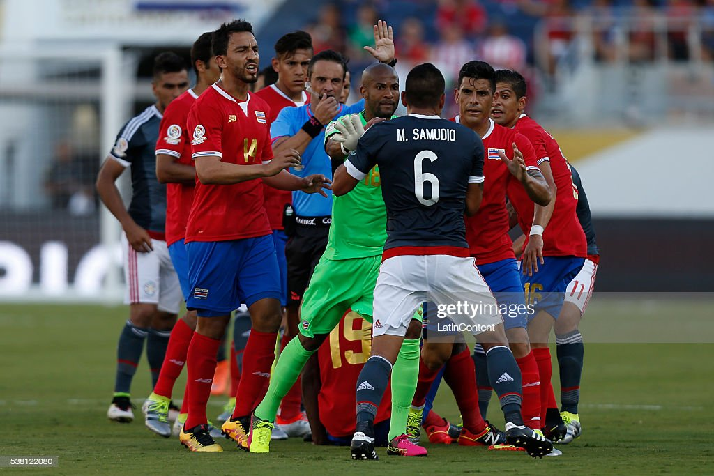 Miguel Samudio #6 of Paraguay clashes with players of Costa Rica at midfield after an injury during a group A match between Costa Rica and Paraguay at Camping World Stadium l as part of Copa America Centenario US 2016 on June 04, 2016 in Orlando, Florida, US.