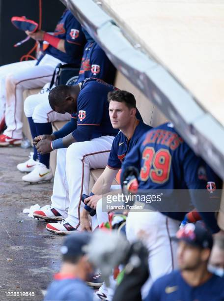 Miguel Sano and Max Kepler of the Minnesota Twins sit in the dugout after being defeated by the Houston Astros in Game Two in the American League...