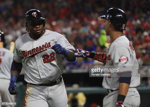 Miguel Sano of the Minnesota Twins celebrates a home run with Jorge Polanco in the fifth inning against the Texas Rangers at Globe Life Park in...