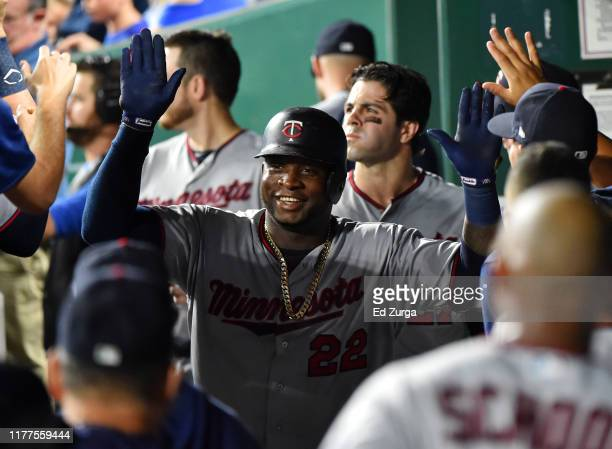 Miguel Sano of the Minnesota Twins celebrates his two-run home run with teammates in the second inning against the Kansas City Royals at Kauffman...