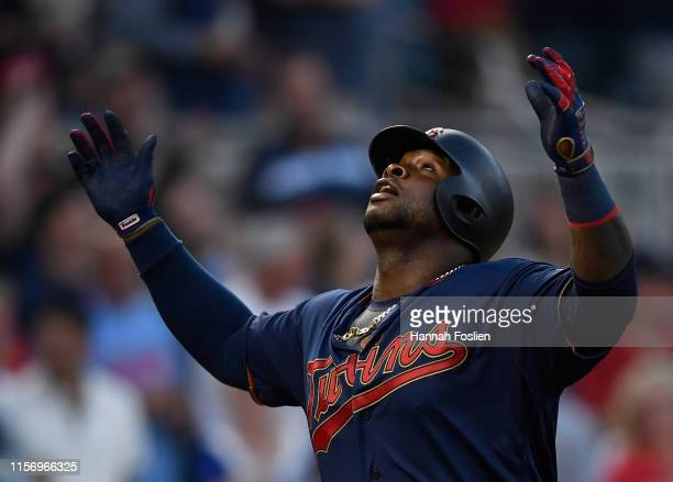 Miguel Sano of the Minnesota Twins celebrates hitting a solo home run as he rounds the bases against the Oakland Athletics during the seventh inning...