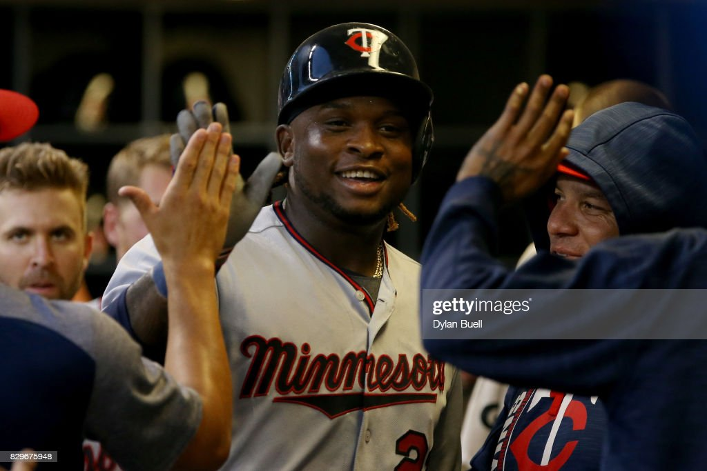 Miguel Sano #22 of the Minnesota Twins celebrates with teammates after scoring a run in the third inning against the Milwaukee Brewers at Miller Park on August 10, 2017 in Milwaukee, Wisconsin.